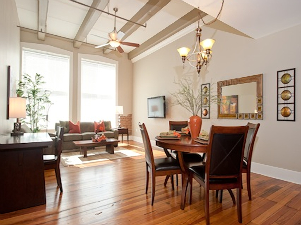 High Ceilings With Exposed Beams and Piping